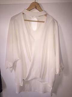 Light weight loose high neck top size 8-10