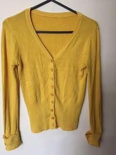 Bright yellow cardigan