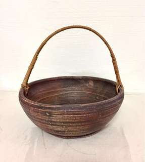Vintage hand crafted rustic pottery bowl basket with fine rattan handle