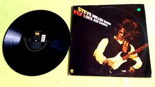 STEVIE MILLER BAND . fly like an eagle ● SUPER LOVER CEE & CASANOVA RUD . ( buy 1 get 1 free )  Vinyl record