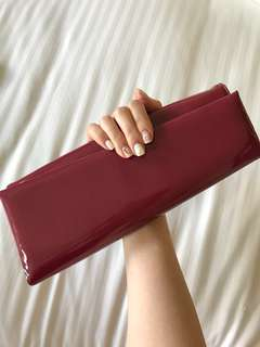 Christian Louboutin clutch patent leather