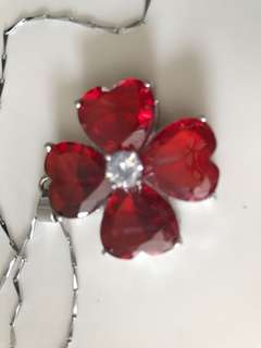 Stainless steel pendant with man made ruby cum zicornia