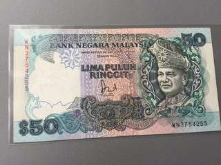 Malaysia $50 6th Series aUNC Foxing around edge