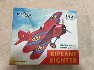 Mechanical wind-up biplane fighter