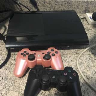 PS3 Slim with games and controller