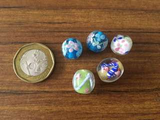 Assorted glass beads with floral designs