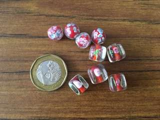 Glass beads red with pink floral design