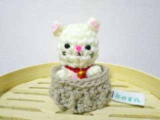 Cat amigurumi in basket