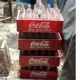 4 cases of empty coca-cola bottles 200 ml.