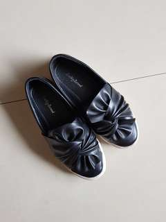 Black ribbon slip on