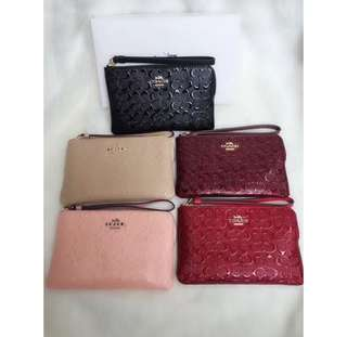 AUTHENTIC COACH SIGNATURE EMBOSSED WRISLET
