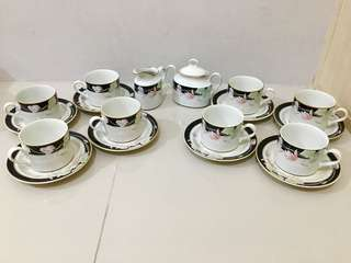 Teacup set with sugar and creamer containers