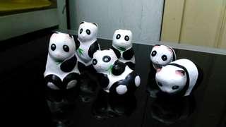 Vintage Clay Miniature pandas.
