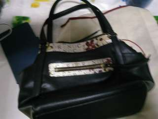 ladY,hand bag two strap given two side pocket compartment  3 zip layer compartment center stap for security attach as shown