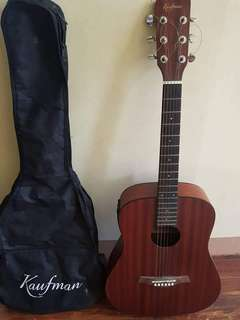 Kaufman Guitar with pickup, guitar case, capo and audio cord.