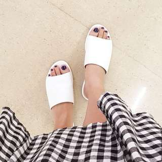 White Flat sandals. Made in marikina. Available in sizes 6 and 7