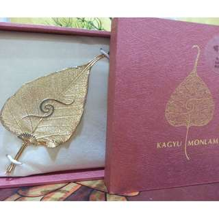 🚚 The Kagyu Monlam logo golden leaf