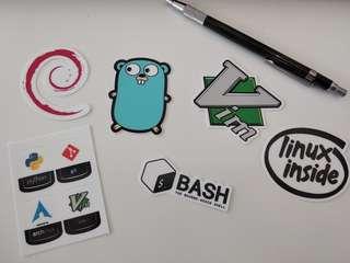 Stickers for programming languages, Vim, Official Bash, Debian, Linux Inside, GoLang.