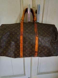 Tas Louis Vuitton travel bag
