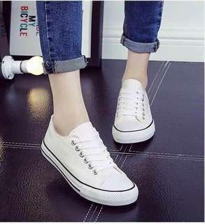 On hand white shoes