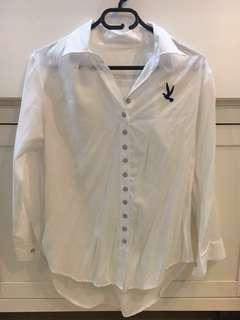 White flowy blouse with bird patch
