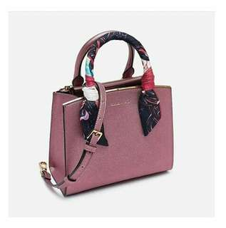 Charles and keith with dustbag
