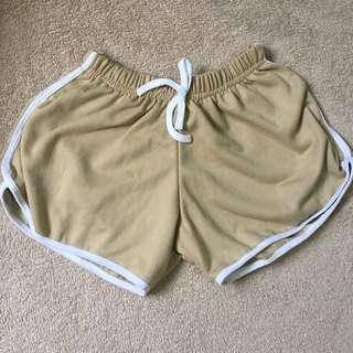 Cream dolphin shorts