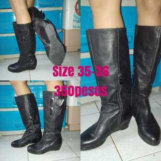 Boots with hidden wedge