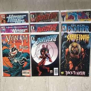 9 copies of Marvel Comics