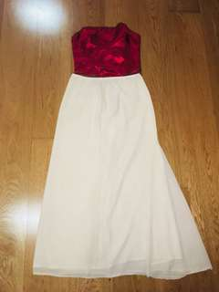 Red top with beige long skirt