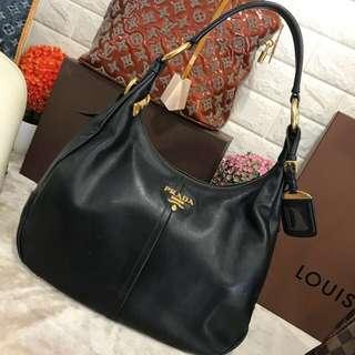 Prada bag. We buy authentic luxury bag watch gold