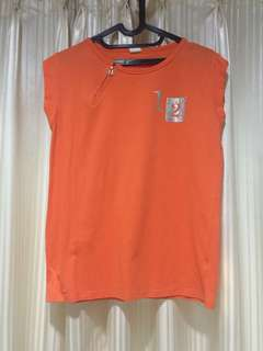 Orange zip sleeveless top