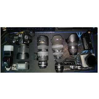 Nikon D90 - Nikon 80-200/f2.8 Sigma 24-70/f2.8 Tokina 12-24/f4 50/f1.8 plus accessories