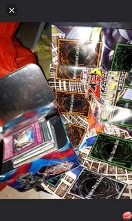 Yogioh cards set in tin around 60 plus cards