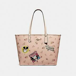 REVERSIBLE CITY ZIP TOTE WITH FLORAL MIX PRINT AND MINNIE MOUSE PATCHES COACH F29359 VINTAGE PINK