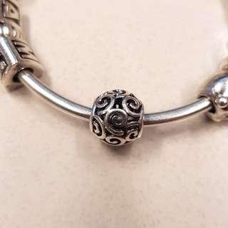 Pandora swirl charm