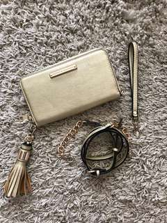 Strapped wallet clutch with removable long and wrist strap with tassels gold