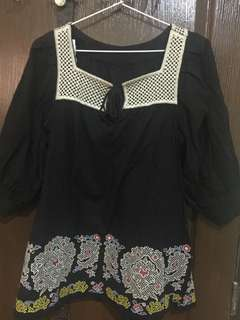 Oversized embroidered top