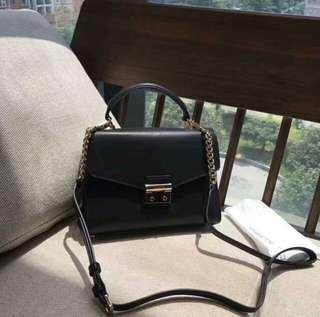 Authentic MK Sloan Leather Satchel