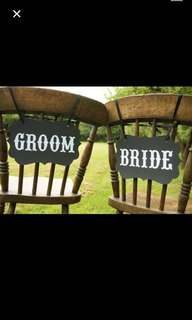 $2 a pair: Bride and groom signboard