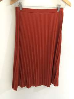 Pleated midi skirt In brick color