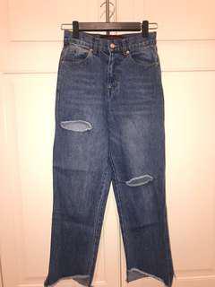 Ripped cut blue denim jeans