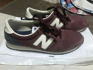 Red New Balance athletic shoes