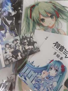 Black rockshooter and Hatsune miku merchandises (posters + 2 coloring book + postcards)