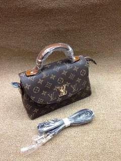 LV Mylockme Hand & Sling Bag