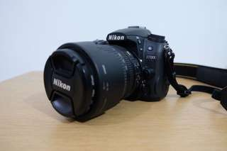 Nikon D7000 with 18-105mm lens, 2 batteries, and carry bag