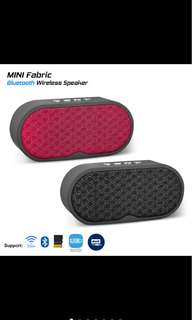 Mini fabric bluetooth speaker