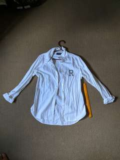 White women's polo with sequins shaped as letter R