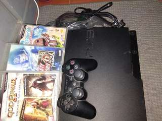 Playstation 3 with a controller and 3 games