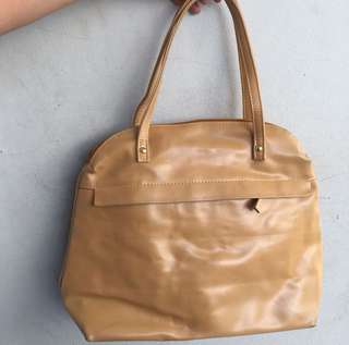 Tas leather